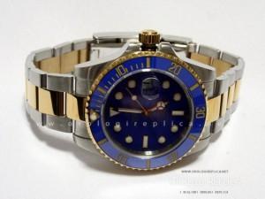 Rolex Submariner acciaio oro quadrante blu ghiera rosso blu